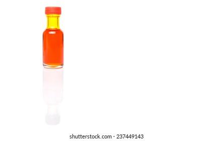 Liquid orange food color additive over white background