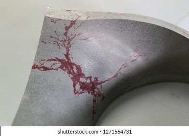 Liquid penetrant test  on the section of elbow to detect stress corrosion cracking as appeared in multiple red lines on the white background