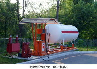 Liquid propane gas station at morning. LPG station for filling liquefied gas into the vehicle tanks. Environmentally friendly fuel for car.