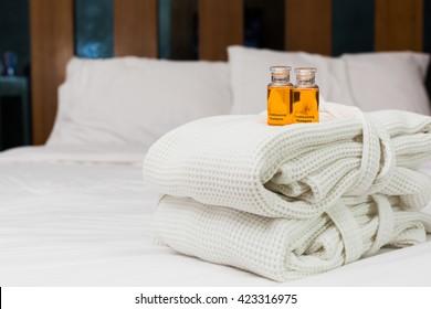 Liquid shampoo put on bathrobe in room.