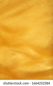 Liquid shiny gold in a soft texture