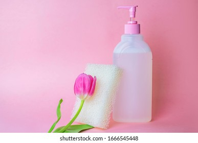 Liquid soap for women with a dispenser on a pink background. cleanser concept. Means for intimate hygiene. Gentle environmentally friendly beauty product for women