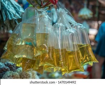 Liquid spices in the plastic bag at the Belen Market. Belén Mercado. Iquitos. Peru. South America.