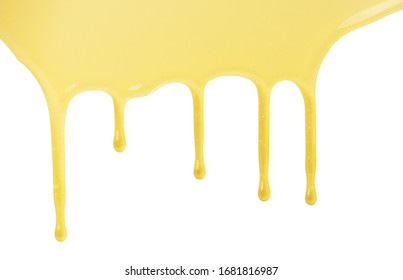 Liquid sweet flowing honey drops isolated on white background