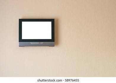 Liquid-crystal television receiver on wall. Isolated white screen. Copy space