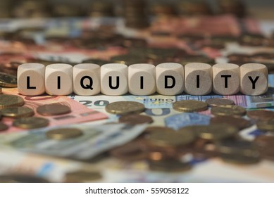 liquidity - cube with letters, money sector terms - sign with wooden cubes