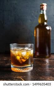 Liquor and liquor bottles on wooden table
