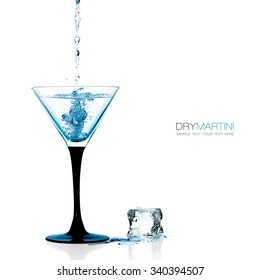 Liquor falling into a cocktail glass of dry martini. Gin cocktail isolated on white background