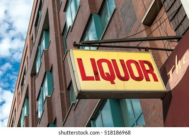 A liquor store sign on a residential building in Manhattan.