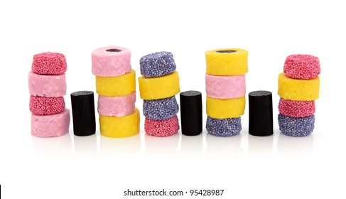 Liquorice allsort sweets in colorful abstract stack design isolated over white background.