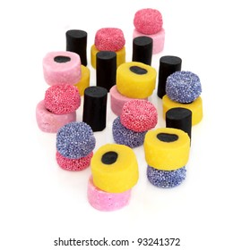 Liquorice allsort sweets is colourful abstract design isolated over white background. Selective focus.