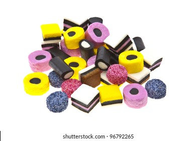 Liquorice allsort sweets in colourful abstract stack design isolated over white background.