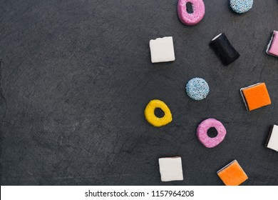 Liquorice allsorts candy sweets on dark background