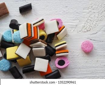 Liquorice Allsorts Sweets on white wooden background