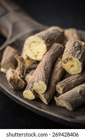 Liquorice roots on wooden spoon