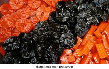 Liquorice snails, shiny, red and black. Background, texture, close-up,