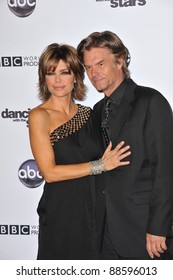 Lisa Rinna & husband Harry Hamlin at the 200th episode party for Dancing With The Stars at Boulevard 3 in Hollywood. November 1, 2010  Los Angeles, CA Picture: Paul Smith / Featureflash