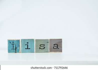 Lisa. Wooden letters on white background