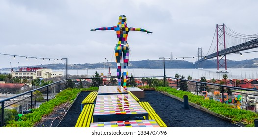Lisboa, Portugal, 10.03.2018: LX Factory - art space in Lisboa. A colorful sculpture of a woman ready to fly.