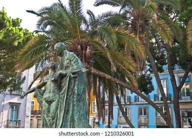 Lisboa, Portugal - August 9, 2012: Green statue under palm trees in Lisboa Portugal