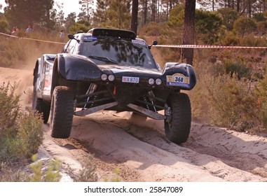 LISBOA, PORTUGAL - JANUARY 6: BERNARD ERRANDONEA of the FRA, and Buggy SMG, participating in the Raly Lisboa-Dakar on January 6,2007 in Lisboa, Portugal.