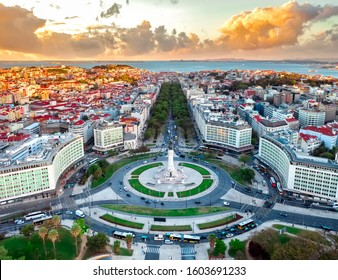 Lisbon aerial skyline panorama european city view on marques de pombal square monument, sunset outside crossroads portugal