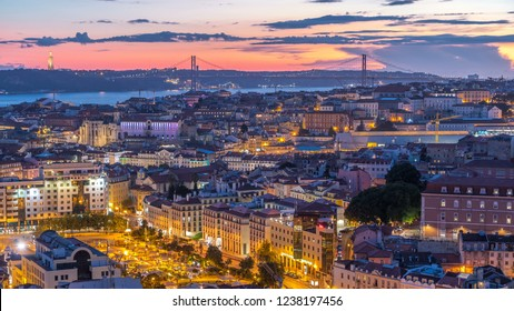 Lisbon after sunset aerial panorama view of city centre with red roofs at Autumn day to night transition timelapse, Portugal. Top view from Miradouro da Nossa Senhora do Monte viewpoint