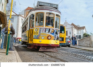 LISBON - APRIL 01 , 2018 : Touristic electric tram in a street of downtown Lisbon, Portugal