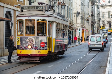 LISBON - APRIL 3: Unidentified tourist gets into the famous 28 line tram on April 3 2018 in Lisbon, Portugal