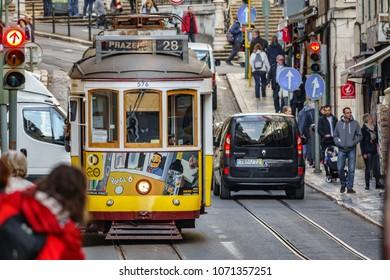 LISBON - APRIL 9: Unidentified tourist wait for the famous 28 line tram on April 9 2018 in Lisbon, Portugal