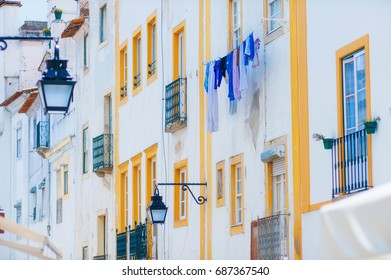 Lisbon beautiful house white facade with pretty yellow windows