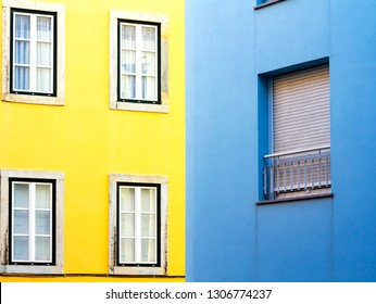 Lisbon buildings - bright blue and bright yellow just next to it.