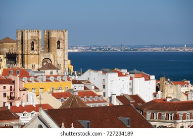 The Lisbon Cathedral  (the Se) surrounded by residential houses of Alfama and Baixa with Tejo river on the background as seen from the observation platform of Santa Justa Lift. Lisbon. Portugal.