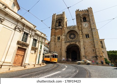 The Lisbon Cathedral with a traditional yellow tram in Lisbon, Portugal