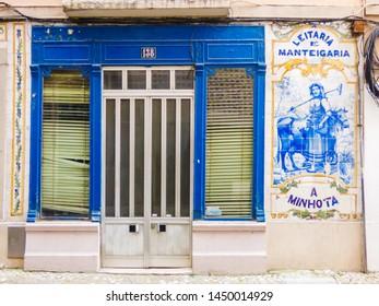 """Lisbon - Circa April 2017: Facade of """"Leitaria e Manteigaria A Minhota"""" bakery with traditional blue portuguese tiles in Lisbon"""