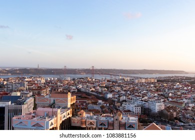 Lisbon cityscape from above at sunset with 25 de Abril bridge, Portugal