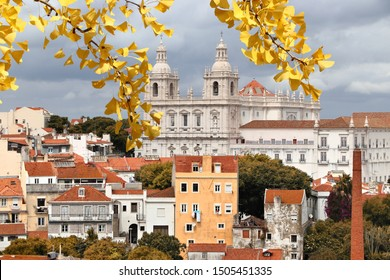 Lisbon cityscape with autumn leaves and Monastery of Sao Vicente de Fora - Alfama neighborhood.