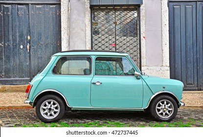 LISBON - DECEMBER 25, 2012: Old fashioned light blue Mini in the street of Lisbon on December 25, 2012. The Mini is a small cars made by the British Motor Corporation.