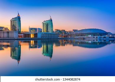 Lisbon - February 2019, Portugal: Sunset at The Nations Park (Parque das Nações) in Lisbon. Modern buildings and Altice Arena mirrored in the water