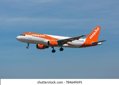 Lisbon International Airport ( LIS), Lisbon, Portugal - 06.08.2017. Passenger aircraft Airbus A320 of easyJet Airlines in flight. Blue sky in the background.