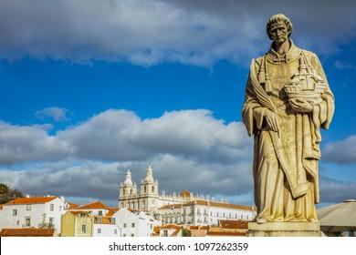 LISBON - JANUARY 1: Sculpture of Sao Vicente on January 1, 2018 in Lisbon. The patron saint of Lisbon, holding Lisbon symbols the caravel and the seagulls (Raul Xavier, circa 1940)
