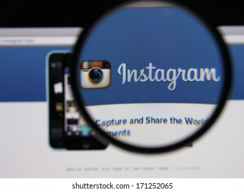 LISBON - JANUARY 14, 2014: Photo of Instagram homepage on a monitor screen through a magnifying glass.