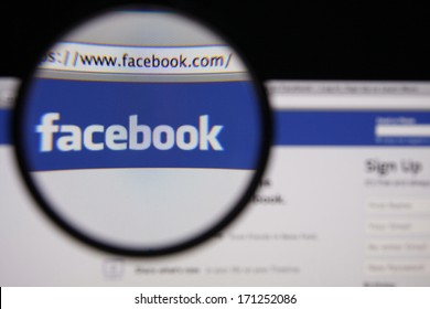 LISBON - JANUARY 14, 2014: Photo of Facebook homepage on a monitor screen through a magnifying glass.