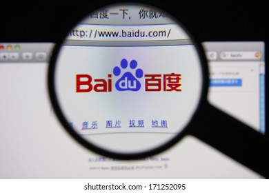 LISBON - JANUARY 14, 2014: Photo of Baidu homepage on a monitor screen through a magnifying glass.