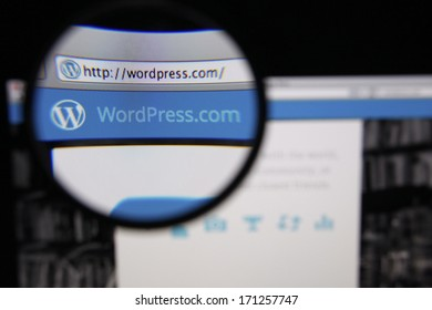 LISBON - JANUARY 14, 2014: Photo of WordPress homepage on a monitor screen through a magnifying glass.