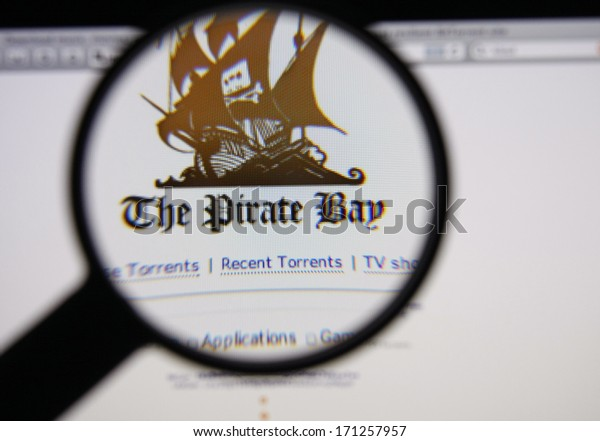 LISBON - JANUARY 14, 2014: Photo of The Pirate Bay homepage on a monitor screen through a magnifying glass.