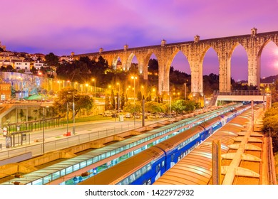 "Lisbon - January 2019, Portugal: Evening view of the historic aqueduct in Lisbon (Aqueduto das Aguas Livres), Train station ""Campolide"""