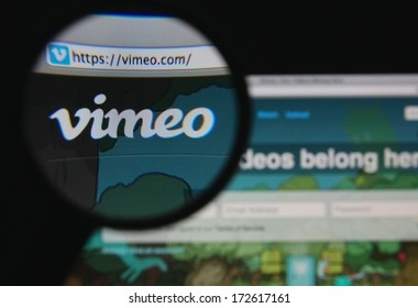 LISBON - JANUARY 22, 2014: Photo of Vimeo homepage on a monitor screen through a magnifying glass.