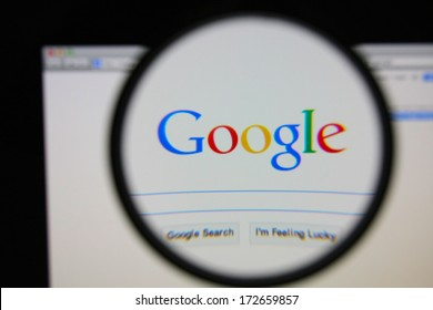 LISBON - JANUARY 22, 2014: Photo of Google homepage on a monitor screen through a magnifying glass.