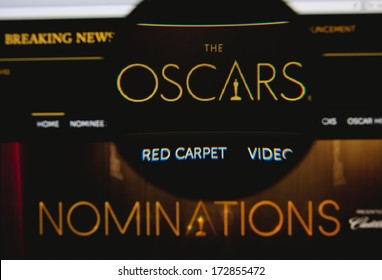 LISBON - JANUARY 23, 2014: Photo of the Academy Awards homepage on a monitor screen through a magnifying glass.